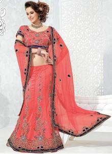 Adorning Rose Pink Patch Border Work Net Lehenga Choli