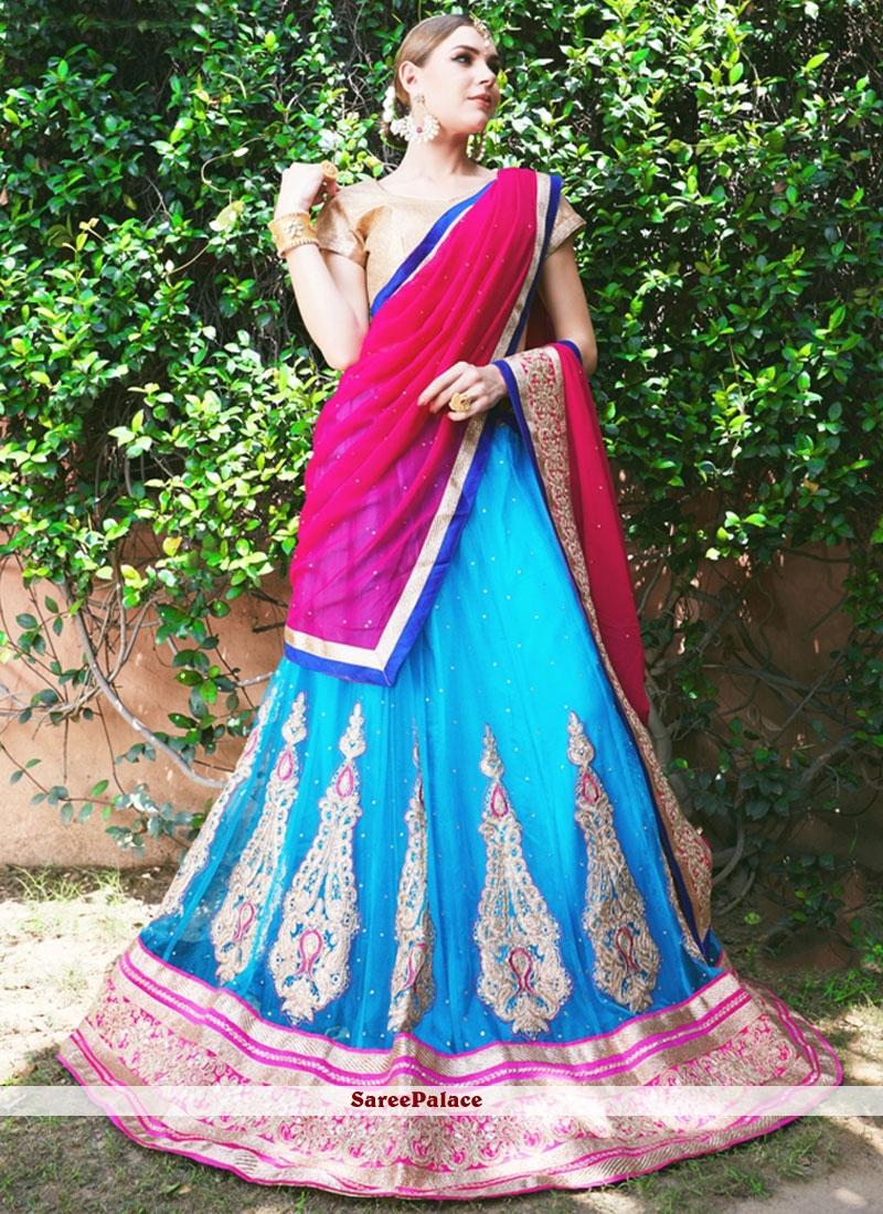 Aspiring Hot Pink and Turquoise Net Lehenga Choli