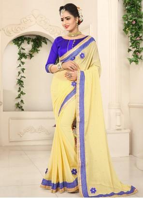 Dazzling Yellow Lace Work Faux Georgette Designer Saree