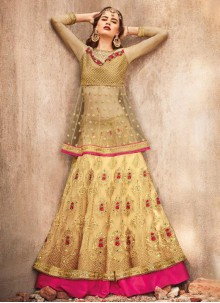 Embroidered Net Gold Lehenga Choli