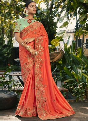 Embroidered Peach Faux Georgette Traditional Saree