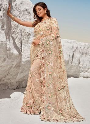 Embroidered Peach Net Bollywood Saree