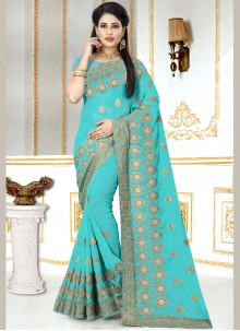 Faux Georgette Embroidered Classic Designer Saree in Blue