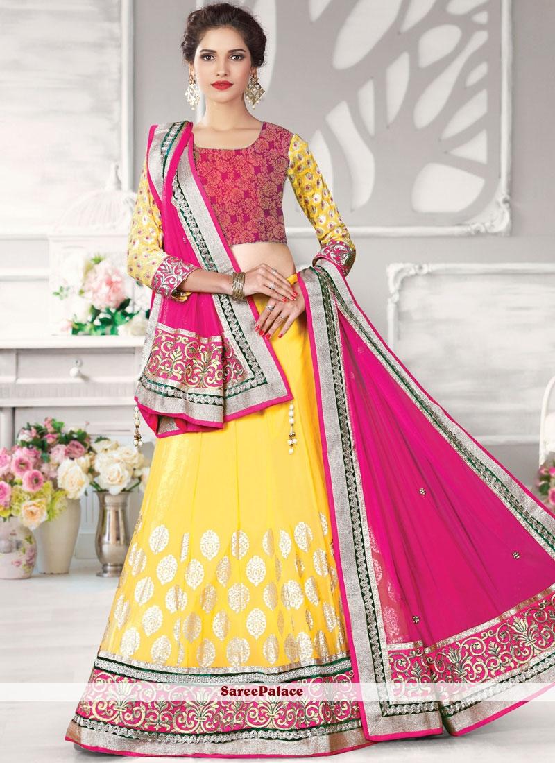 e9cd90576b Buy Girlish Net Hot Pink and Yellow Lehenga Choli Online