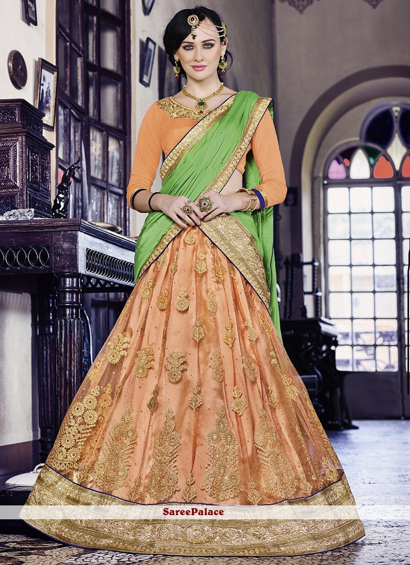 Hypnotic Net Orange Lehenga Choli