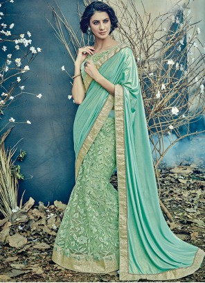 Imposing Net Patch Border Work Lehenga Saree