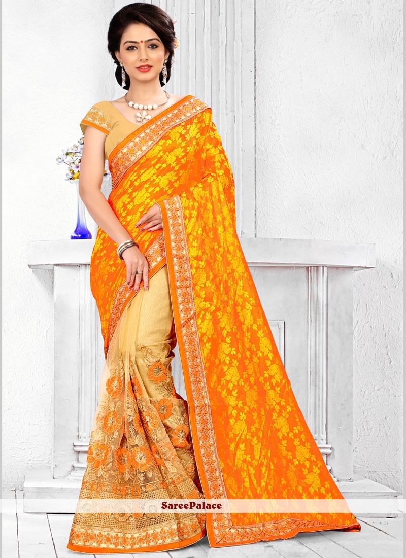 Invaluable Jacquard Silk Beige and Mustard Patch Border Work Half N Half Designer Saree