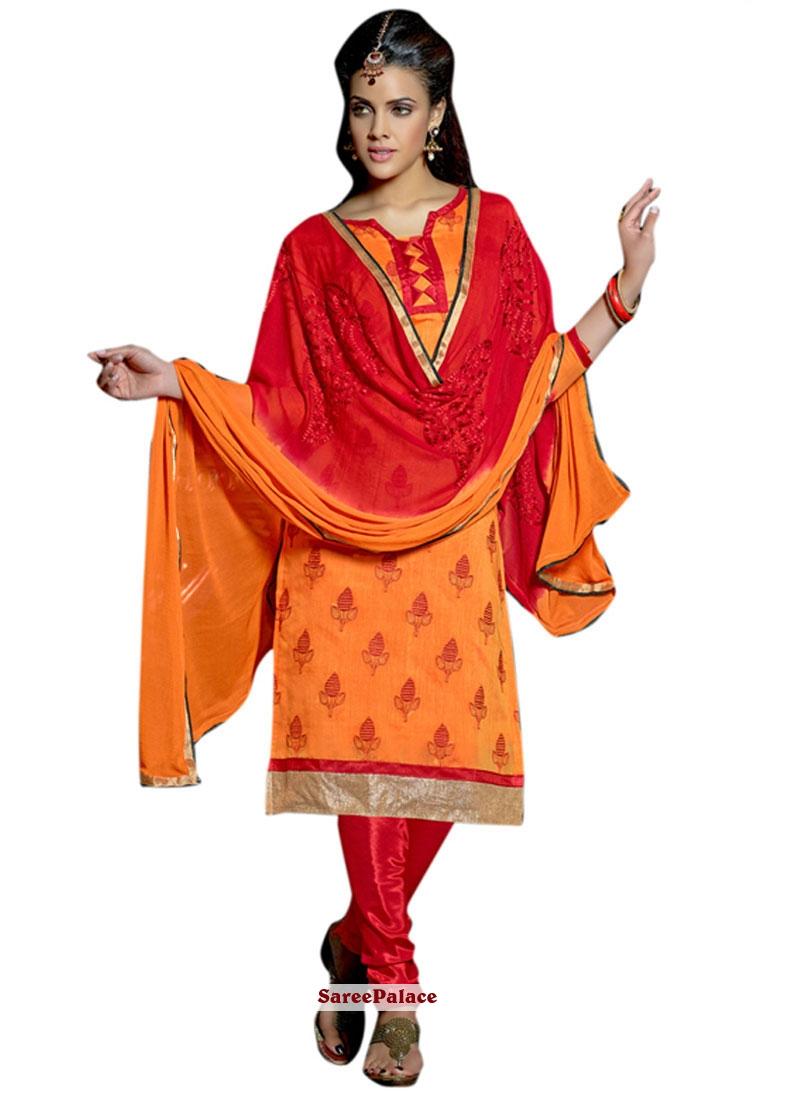 Mesmeric Orange Lace Work Churidar Suit