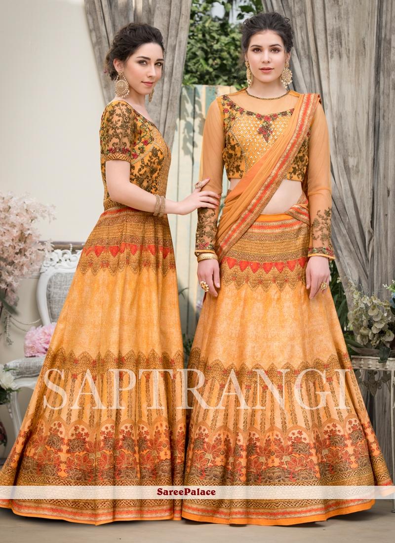 Peach Mehndi Fancy Fabric Lehenga Choli