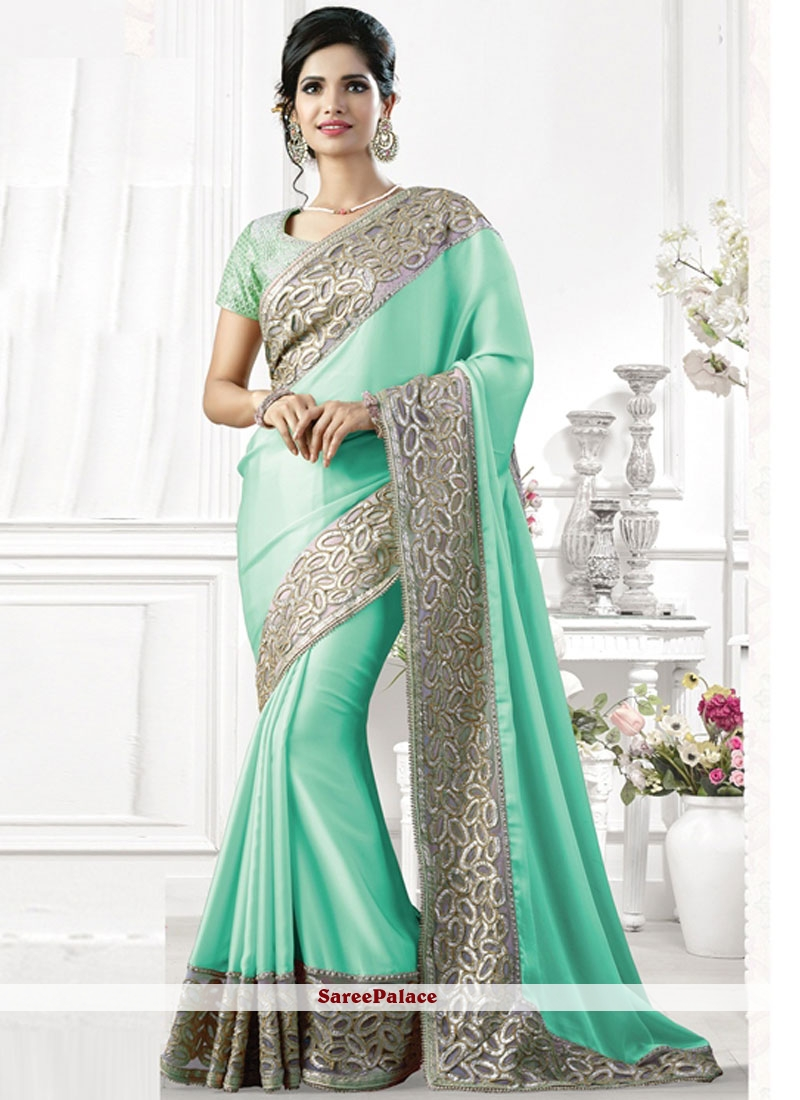 Piquant Faux Georgette Cut Work Traditional  Saree