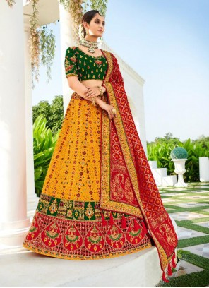 Silk Embroidered Lehenga Choli in Green, Mustard and Red