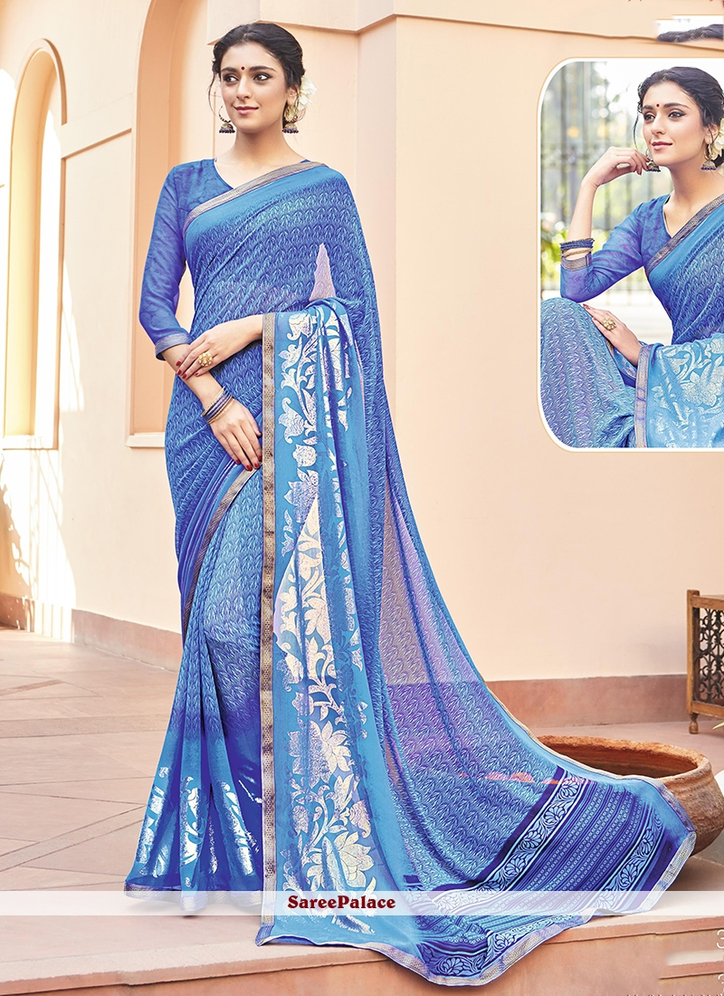 Tantalizing Blue Print Work Faux Georgette Printed Saree
