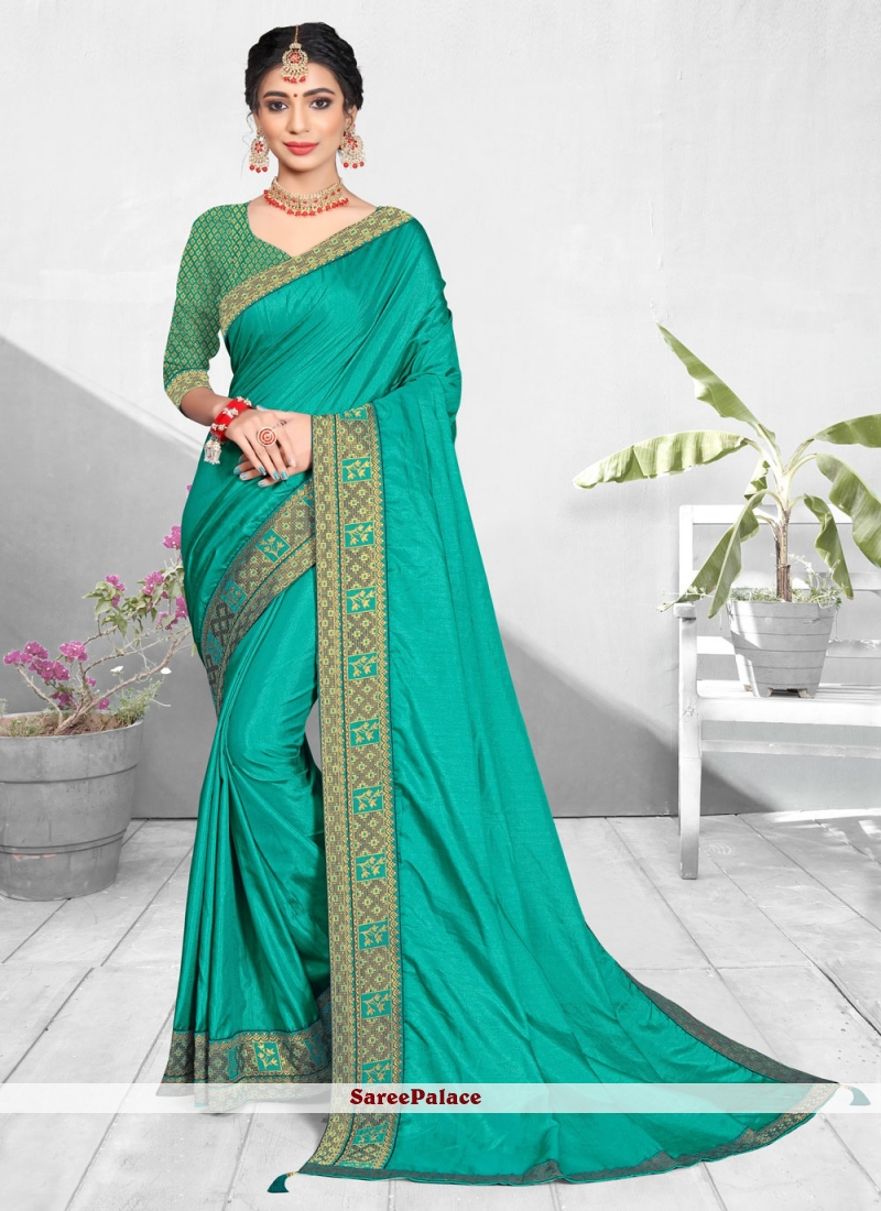 Turquoise Vichitra silk Patch Border Traditional Saree